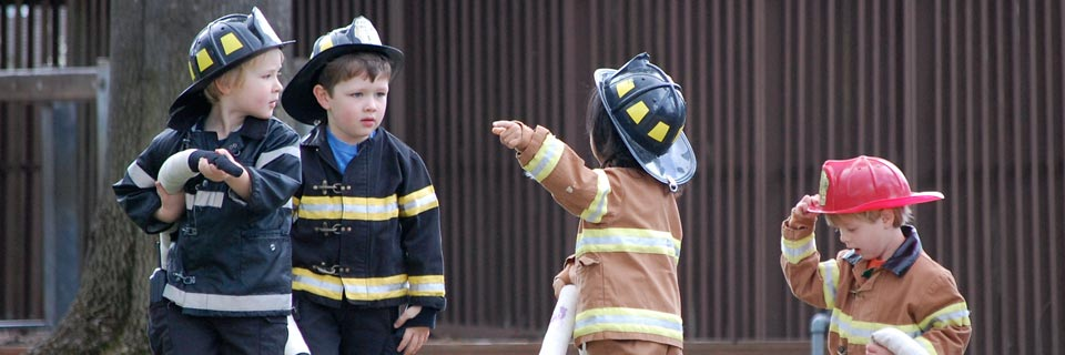boys in firefighter outfits